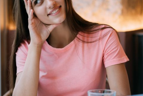 Placeit - Portrait of a beautiful young brunette in cafe